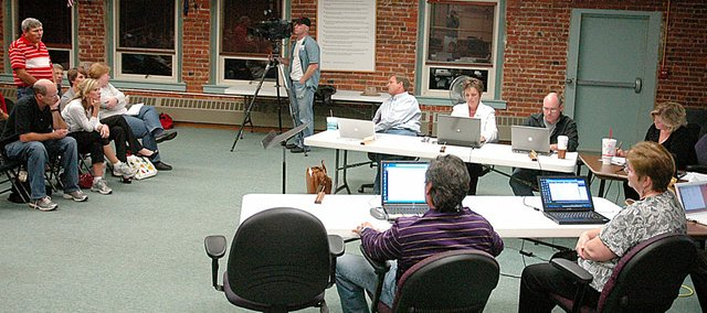 John Hulce, standing at left, speaks to the Baldwin School Board Monday night during the public comment portion of Monday's meeting.