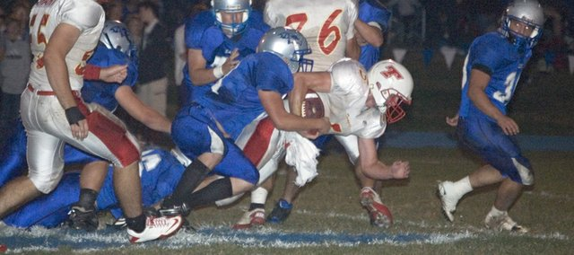 Tonganoxie High junior running back Brady Waldeier dives forward on a carry against Perry-Lecompton on Friday. The Chieftains lost their district opener on the road, 55-35.