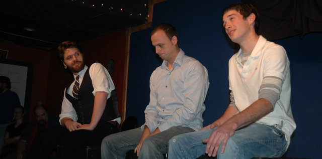 "Performers play experts in audience-chosen topics during ""The Next Big Improv Show,"" part of ImpFest 2010, an improvisational comedy festival going on this weekend at the Roving Imp Theater and Coffee House. Pictured are, from left, Christian Robinson, Kansas City, Mo., Derek Ozkal, Bonner Springs, and Sly Finck, Kansas City, Kan."