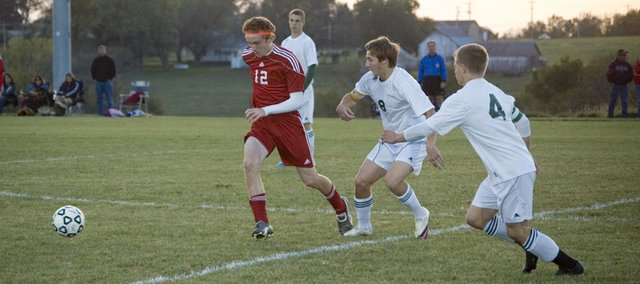 Tonganoxie High captain Zach Tallent races toward the ball in the early minutes of the Chieftains' 5-0 loss at Basehor-Linwood on Monday.