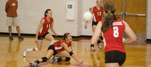 Tonganoxie High senior Molly O&#39;Hagan gets on the floor for a dig in the Chieftains&#39; Kaw Valley League semifinal loss to Mill Valley on Saturday at Bonner Springs. THS finished third with a 4-1 record.
