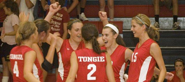 Members of the Tonganoxie High volleyball team celebrate in this Mirror file photo from the team's win over Atchison on Aug. 31. The Chieftains will play host to a Class 4A sub-state tournament on Saturday as the No. 2 seed.