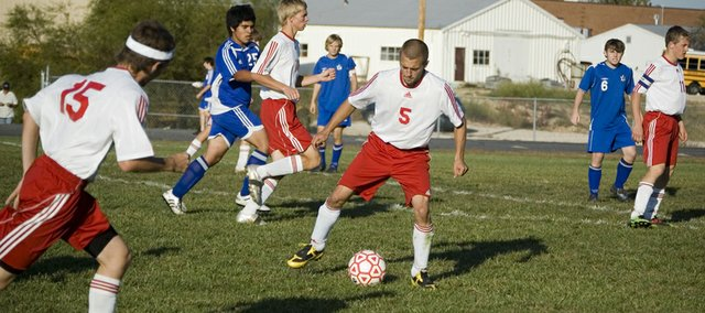 Tonganoxie High senior Jake Willis prepares to move the ball ahead as the Chieftains attack in the second half of their 1-0 Senior Night loss to Leavenworth on Thursday.