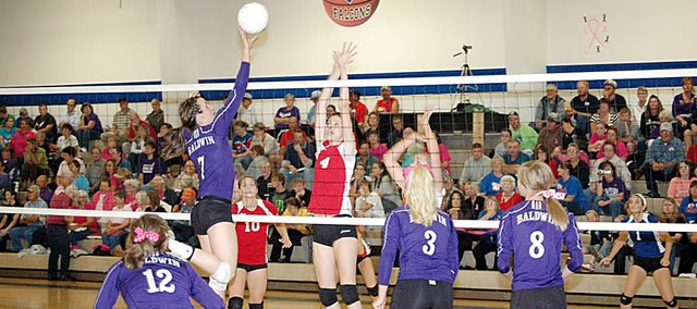 Baldwin High School junior Madeline Brungardt tips the ball over the net Tuesday night at West Franklin High School. The Bulldogs beat West Franklin and Santa Fe Trail to close the regular season on two victories.