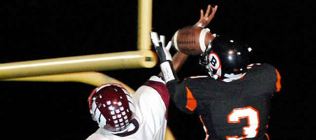 Bonner Springs wide receiver Steve Williams hauls in a touchdown catch during the first half against Washington. BSHS won the game, 54-6, and earned a berth in the Class 5A state playoffs.