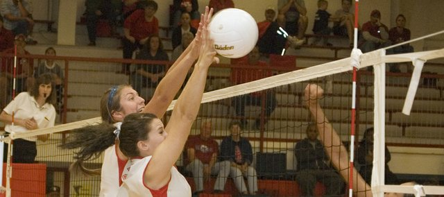Tonganoxie High's Molly O'Hagan and Hannah Kemp deny a Piper attack on Saturday in a Class 4A sub-state semifinal at THS. The Chieftains, the No. 2 seed, were upset by the No. 6 Pirates, 26-24, 17-25, 25-23.