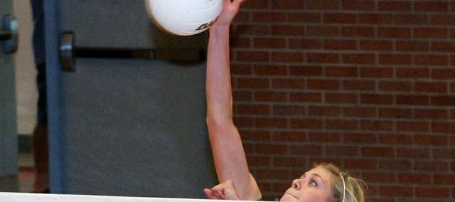 Basehor-Linwood junior Cara McCarty goes for a kill during the Bobcats' substate match against St. James Academy.