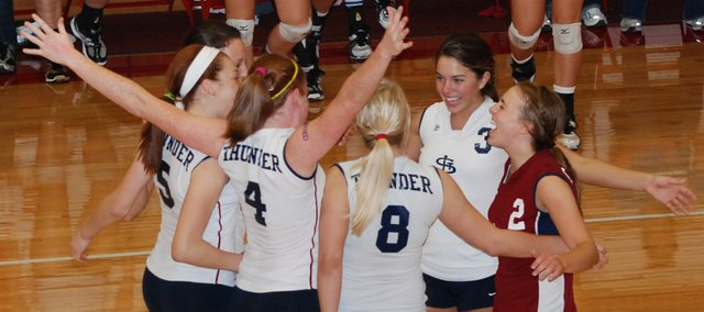 The St. James Academy volleyball team celebrates after scoring the final point of the Class 4A substate championship match against Piper. Sheridan Zarda (2) fired an ace to cap a 16-0 match-ending run that propelled the Thunder back to state.
