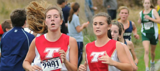 Tonganoxie High freshmen Emma Stilgenbauer and Taylar Morgan run Saturday at a Class 4A regional cross country meet at Wyandotte County Park in Bonner Springs. The THS girls placed sixth out of 12 teams at the regional.