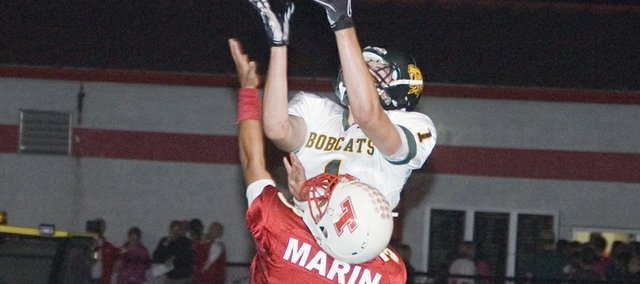 Shawn Marin tries to get up with Basehor-Linwood wide receiver Ryan Murphy on a deep pass Friday night. The senior Tonganoxie High defensive back was able to force an incompletion but the Chieftains fell, 41-16, in the district rivalry game.