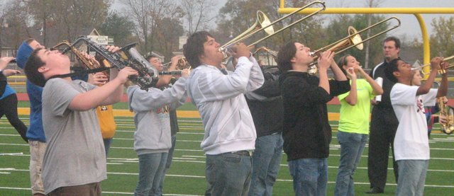 Trombone and saxophone players in the Basehor-Linwood High School marching band blast out a sustained note while rehearsing the Boston song Foreplay/Long Time early Monday morning. Nearly three months after their season began with the long, hot days of band camp, the band is preparing this week for its final festival competition at the University of Central Missouri.