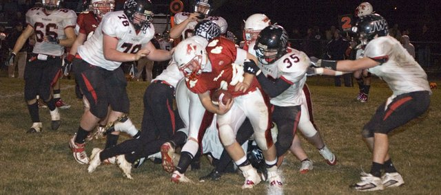 Tonganoxie High freshman Shane Levy carries the ball for the Chieftains in the second half of the team&#39;s 41-28 district home loss to Jeff West Thursday night at Beatty Field.