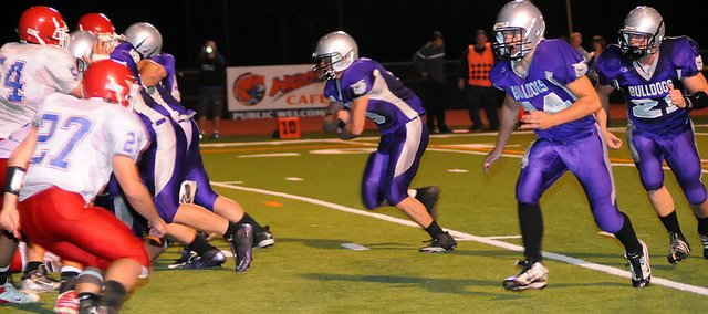 Baldwin High School senior Josh Hoffman carries the ball Friday night. Hoffman scored four touchdowns as the Bulldogs beat Santa Fe Trail 53-14.