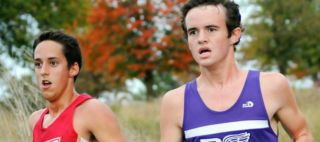 Baldwin High School senior Kyle Garcia, right, runs along side a Tonganoxie runner during Saturday's 5-kilometer race at Wyandotte County Park. Garcia finished seventh in the race and was the sixth Bulldog across the finish line. The Bulldogs scored 20 points to win the team title.
