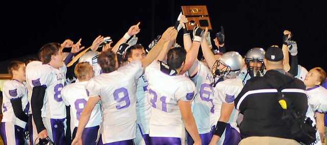 Baldwin High School's football team celebrates its district championship after receiving its district title plaque after beating Eudora 20-13 Thursday night.