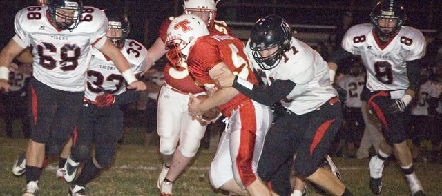 Senior lineman Dylan Fosdick becomes a running back Thursday against Jeff West High as a part of Tonganoxies elephant-I backfield package. Fosdick was one of three THS senior linemen to carry the ball on the opening drive of the Chieftains 41-28 district loss at Beatty Field.
