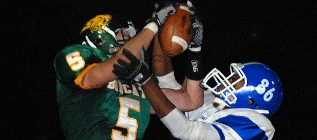 Basehor-Linwood tight end Ben Johnson hauls in a touchdown catch during the third quarter of the Bobcats&#39; 36-22 loss to Sumner Academy in the Class 4A state playoffs.