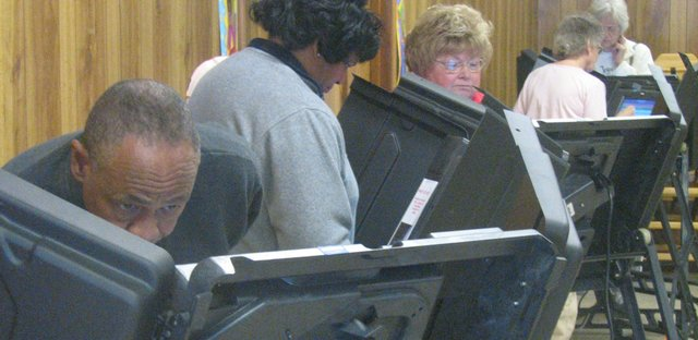 Voters make their choices Tuesday afternoon at Holy Angels Catholic Church in Basehor, where residents of the city of Basehor were assigned to vote.