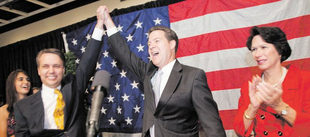 Lt. Gov. Jeff Colyer, left, and Gov. Sam Brownback with his wife, Mary, at his side, celebrate winning in Tuesday's mid-term election during a GOP Clean Sweep party Tuesday, Nov. 2, 2010 in Topeka.