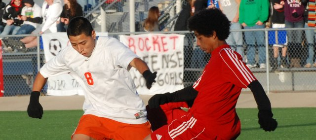 Bonner Springs senior Jose Lopez tangles with a Rose Hill player for possession of the ball during the Braves' 1-0 loss in the Class 4-1A state semifinals.