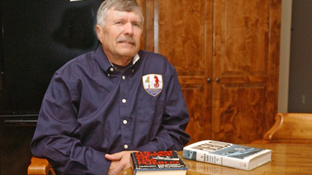 Steve Woelk of Basehor relaxes at his home with two books on the USS Pueblo incident. A member of Tonganoxie VFW Post 9271, he was among 83 men serving on the ship when it was captured by the North Koreans in 1968.