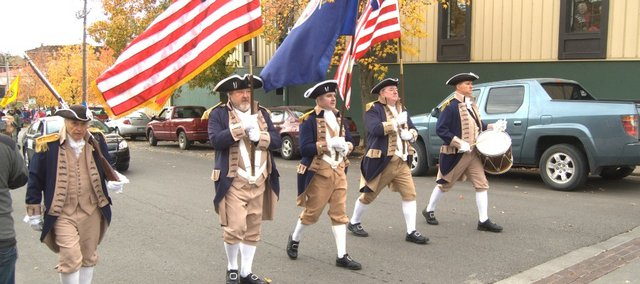 Participants marching in Thursday's Leavenworth County Veterans Day Parade in dowtown Leavenworth wear military garb of years ago.