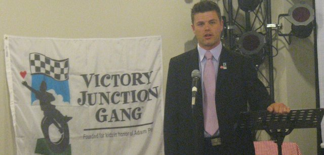 Kyle Brenner, director of development for Victory Junction, speaks about the organization's planned Kansas City, Kan., camp at a community meeting Thursday night at the Basehor VFW Post. Brenner, a friend of NASCAR's Petty family, had been involved with the organization's first camp in North Carolina since it opened in 2004.