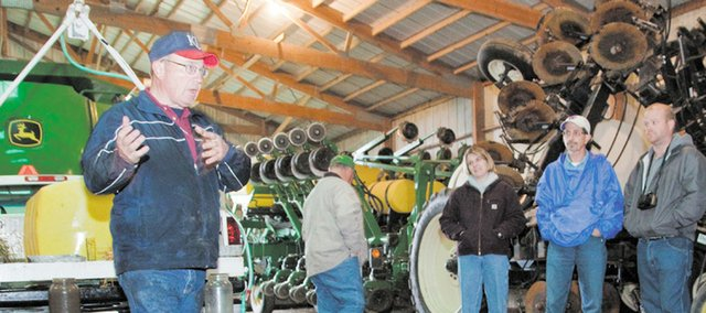 Clyde Mermis, district conservationist, left, discusses how no-till farming, along with ground cover, can keep topsoil from eroding. Mermis talked during the Douglas County Food Policy group tour of Douglas County farms Friday, Nov. 9, 2010. The Food Policy Council will take information from the tour to send recommendations to Douglas County commissioners.