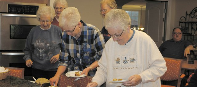 Shawnee Hills Senior Living residents line up to try the desserts that were judged as part of the retirement center&#39;s pumpkin dessert contest.
