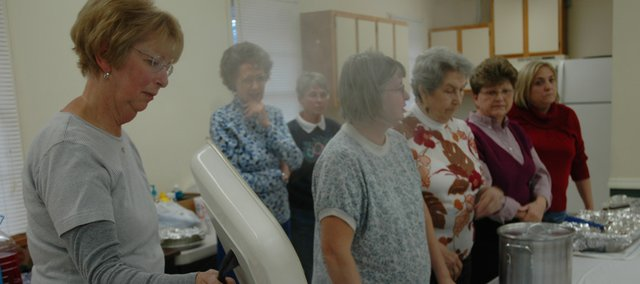 Members of the Bonner Springs VFW Ladies Auxiliary get ready to serve patients of the Dwight Eisenhower Veterans Affairs Hospital in Leavenworth. The hospital allows any veteran patients interested to sign up for a bus ride to Bonner Springs for the annual Thanksgiving Dinner.