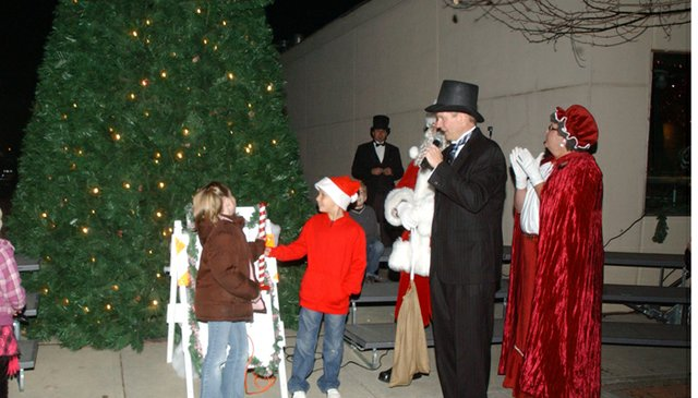 Mayor Jason Ward introduces Tonganoxie Elementary School students Abby Fletcher and Caden Woods to light the Mayor's Christmas Tree. Ward selected the students singled out by their school for their willingness to help other students, teachers and staff.