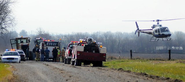 A LifeStar helicopter lands near E. 1550 Road southwest of Baldwin City on Nov. 22, 2010. A 61-year-old woman was flown to Kansas University Hospital after falling down stairs at her home.
