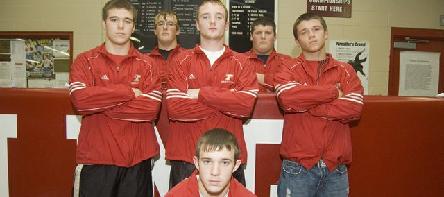 Tonganoxie High wrestling seniors (kneeling) Justin Soetaert, (second row) Ian McClellan, Tyler Hand, Vinnie Angell, (in back) Hank Somers and Cody Stine lead what they think will be a deep, competitive team this season.
