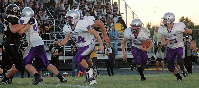 Baldwin High School opened the season with a 32-14 win at Paola. The Bulldogs turned the 2-8 2009 campaign into a 10-2 season in 2010.