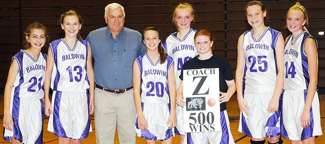 The Baldwin Junior High School eighth-grade girls' varsity basketball team celebrated coach Ted Zuzzio's 500th win Monday evening. Pictured, from left, are Emma Grossner, Maddie Ogle, coach Zuzzio, Emma Stewart, Jordan Hoffman, Emily Simpson, Alexia Stein and Corey Valentine.