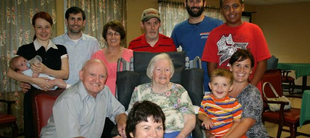 Dolores Finley, seated at center, poses with her family. Pictured from left to right, in back, are grandson Mike Bristow with wife and child, Margaret and Cameron; daughter Carol Bristow with husband, Richard; and grandsons Thomas Bristow and Corey Brantley. Her husband of 60 years, Jim Finely, is seated next to Dolores. Granddaughter Anne Bristow Slusher is holding Dolores' great-grandson, Kellen. Dolores' daughter, Linda Finley, is seated in front.