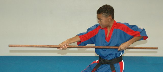 Eric Scott Jr., Bonner Springs, practices one of his world championship karate routines.
