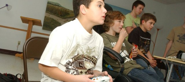 Josh Strutton, blasts Nazi zombies attacking him in a computer game in the Tonganoxie Public Library. Josh and, from left, Paul Thompson, Kobe Fagan and Chris Ayers are among the youngsters who play computer games at the Tonganoxie Public Library.