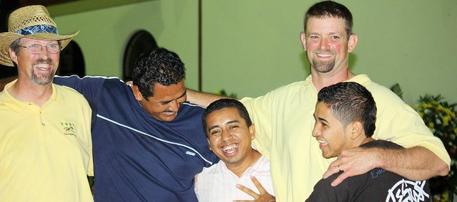 Roger Dressler, left, rural Baldwin City, and his son J.D. Dressler share a laugh with members of the church in Jinotepe, Nicaragua who they became friends with during their weeklong mission trip.