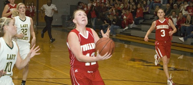 Tonganoxie High junior guard Amanda Holroyd prepares to scoop the ball off the glass on a fast break Friday night against Basehor-Linwood. The layup wasn't allowed, however, because of traveling. The Chieftains lost their season-opener, 31-28.
