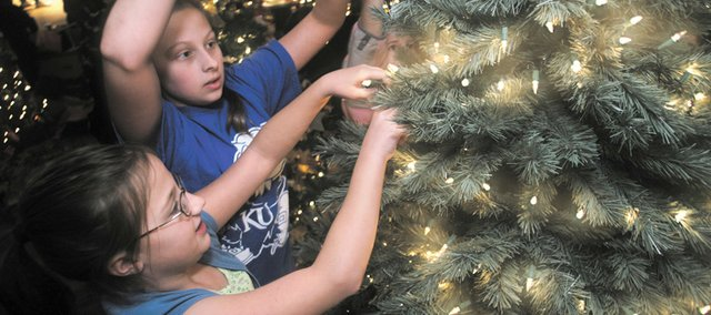 Cherie Sage, state director of Safe Kids Kansas, reminds parents and caregivers to take a few precautions when decorating for Christmas, Hanukkah, Kwanza and other winter festivities.