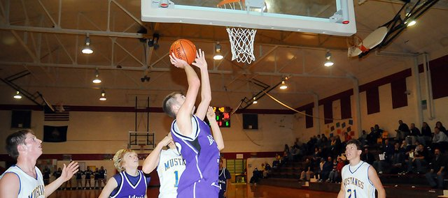 Baldwin High School sophomore Caleb Gaylord scores a layup Tuesday night. The Bulldogs beat Iola 57-42 to earn its first win of the season.