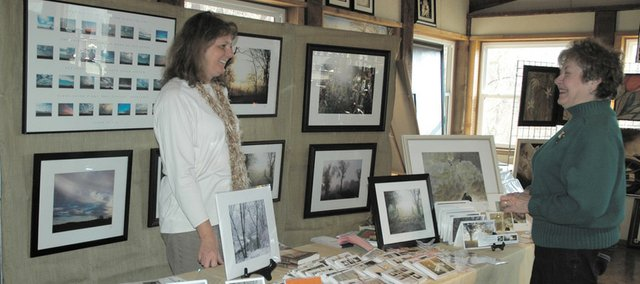 Artist Rose Burgweger (left) and Linda Burol, Kansas City, Kan., talk during the Hollis Winter Art Fair. The fair Saturday afternoon drew 12 artists and about 200-300 people to the center.