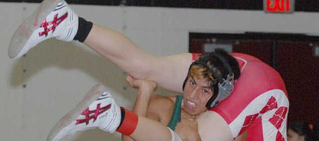Basehor-Linwood junior Antonio Ferro upends his opponent from Tonganoxie during the Kaw Valley League Dual Tournament.