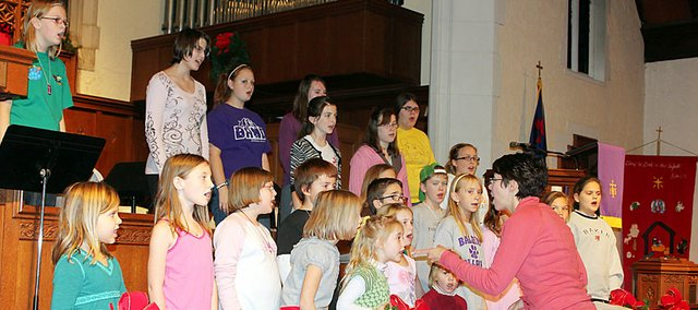 Amy Potterton, Baldwin City Children's Choir director, conducts the choir at practice recently. The choir will perform at 5 p.m. Sunday at the First United Methodist Church.