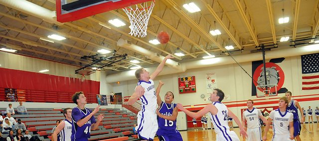 Baldwin High School freshman Cornell Brown shoots a running jump shot over a Louisburg defender Friday night. Baldwin beat the Wildcats 57-54 to place third at the Anderson County Invitational.