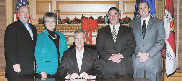 From left, Eudora City Council members Tim Reazin and Ruth Hughs, Gov. Mark Parkinson, Eudora Mayor Scott Hopson and Eudora City Administrator John Harrenstein are pictured after the governor signed the proclamation making Eudora a 2nd Class city.