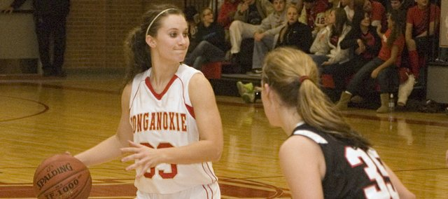 Tonganoxie High sophomore point guard Hannah Kemp looks for an open teammate against Bishop Ward on Tuesday. The pass-first guard keyed a 50-44 Chieftains home win with five fourth-quarter points.
