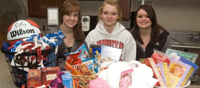 Tonganoxie High School freshmen, from left, Kelsey Lawrence, Ashley Hood and Larissa Willburn are leading a drive of THS students assembling gift baskets to be auctioned off at upcoming home basketball games. Proceeds will go toward Team Tongie to help needy families during the holidays. The effort also is a FCCLA project.
