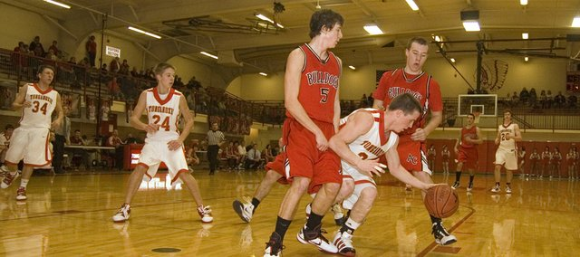 Tonganoxie High point guard Jeremy Carlisle maintains his dribble after driving into the paint late in his team's 47-29 win over Anderson County on Friday at THS.